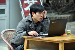 Pengzhou, China: Man Using Computer Royalty Free Stock Photos
