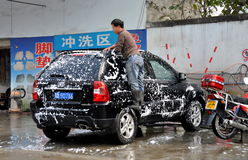 Pengzhou, China: Man Washing Car Stock Photography