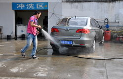 Pengzhou, China: Man Washing Car Royalty Free Stock Photos