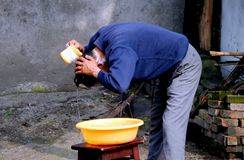 Pengzhou, China: Man Washing His Hair Royalty Free Stock Photos