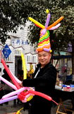 Pengzhou, China: Man Wearing Balloon Hat Royalty Free Stock Image