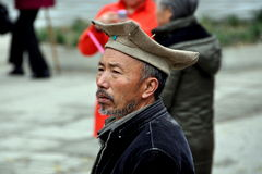 Pengzhou, China: Man Wearing Four-Cornered Hat. Chinese Man wearing a four-cornered knit cap at the Long Xing Monastery in Pengzhou, China Royalty Free Stock Images
