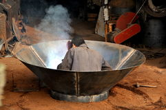 Pengzhou, China: Man Welding Wok Stock Photo