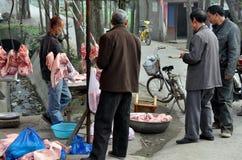 Pengzhou, China: Men Buying Pork Royalty Free Stock Photography