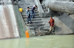 Pengzhou, China: Men Fishing in River Stock Photo