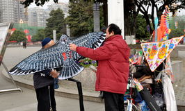 Pengzhou, China: Men Prepare to Fly Paper Kite Stock Photos