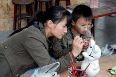 Pengzhou, China: Mom & Son Painting Mickey Mouse Stock Photography