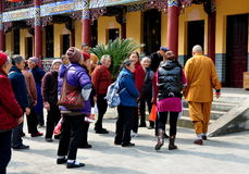 Pengzhou, China: Monk Leading Tourist Group Royalty Free Stock Images
