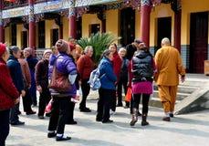 Pengzhou, China: Monk Leading Tourist Group Royalty Free Stock Images