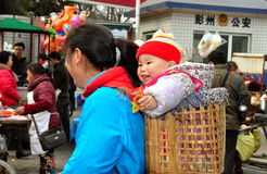 Pengzhou, China: Mother and Baby in Basket Royalty Free Stock Photos