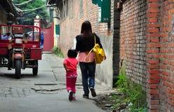 Pengzhou, China: Mother & Daughter Walking on Old Street Stock Photo