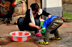 Pengzhou, China: Mother Giving Son a Shampoo Royalty Free Stock Photography