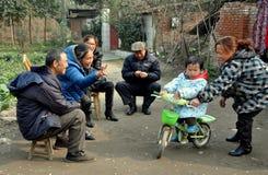 Pengzhou, China: Mother Teaching Child to Ride Bike Stock Photos