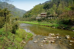 Pengzhou, China: Mountain River & Sichuan House Royalty Free Stock Images