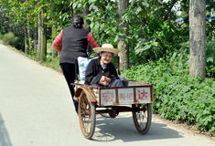 Pengzhou, China: Old Woman in a Cart Royalty Free Stock Images