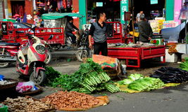 Pengzhou, China: Outdoor Long Xing Marketplace. Vendors display their farm-fresh produce on the street at the outdoor Long Xing marketplace including ginger Stock Photo