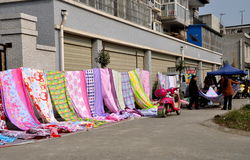 Pengzhou, China: Outdoor Market With Linens Royalty Free Stock Image
