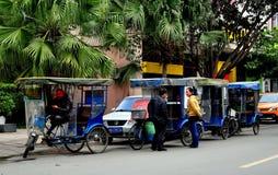 Pengzhou, China:  Pedicab Taxis Waiting for Fares Stock Image