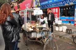 Pengzhou, China: People Buying Food from Street Vendor Stock Photo