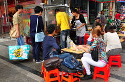 Pengzhou, China: People Buying Food from Street Vendor Stock Images