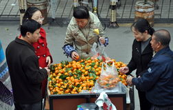 Pengzhou, China: People Buying Oranges royalty free stock photos
