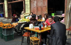 Pengzhou, China: People Eating at Restaurant Stock Photo