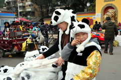 Pengzhou, China: People in Panda Hats Stock Photography