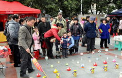 Pengzhou, China: People Playing Ring Toss Stock Photography