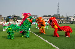 Pengzhou, China: Perfoming Lion Dancers Stock Image