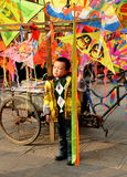 Pengzhou, China: Pouting Little Boy with Kites Royalty Free Stock Images