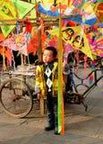Pengzhou, China: Pouting Little Boy with Kites Royalty Free Stock Images