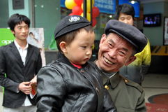 Pengzhou, China: Proud Smiling Grandpa with Baby Stock Photo