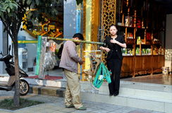 Pengzhou, China: Salesman Selling Hangers Stock Image