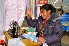 Pengzhou, China: Seamstress with Sewing Machine Stock Image