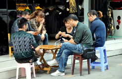 Pengzhou, China: Shopkeepers Playing Cards Royalty Free Stock Photos