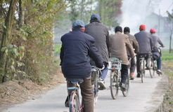 Pengzhou, China: Six Men on Bicycles Royalty Free Stock Image