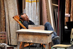 Pengzhou, China: Sleeping Lumber Merchant  Royalty Free Stock Image