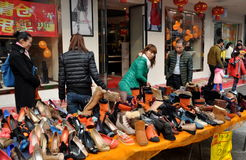 Pengzhou, China: Store Having Shoe Sale Stock Photos
