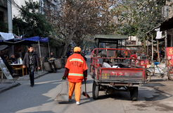 Pengzhou, China: Street Cleaner at Work Stock Image