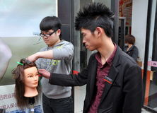 Pengzhou, China: Student Learning to Cut Hair Stock Images