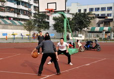 Pengzhou, China: Students Shooting Hoops stock photo