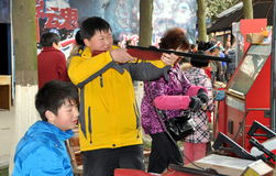 Pengzhou, China: Teen Shooting Gun Stock Image