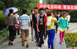 Pengzhou, China: Teens & Kids in Pengzhou Park. A group of Chinese teens and children strolling in Pengzhou Park on an Autumn afternoon in Pengzhou, China Stock Photo