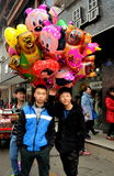 Pengzhou, China: Teens Selling Balloons Royalty Free Stock Photos