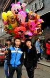 Pengzhou, China: Teens Selling Balloons. Enterprising teenagers selling plastic childrens' balloons on busy Li Ren Jie Street in Pengzhou, China Royalty Free Stock Photos