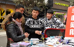 Pengzhou, China: Teens Selling Cellphone Covers Royalty Free Stock Photography