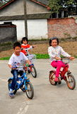 Pengzhou, China: Three Chinese Children Riding Bicycles Royalty Free Stock Photography
