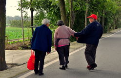 Pengzhou, China: Three Elderly People on Country Road Royalty Free Stock Photo