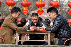 Pengzhou, China: Three Men Playing Cards Stock Photography