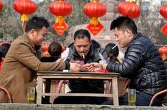 Pengzhou, China: Three Men Playing Cards Stock Photography